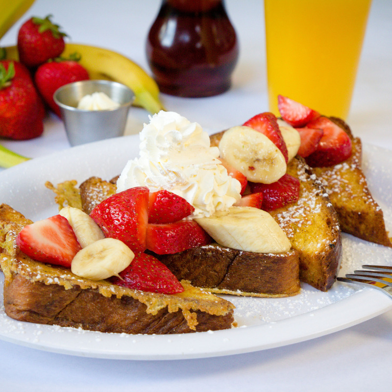 Challah French Toast with Fresh Berries (We make our own challah bread to create this delight)