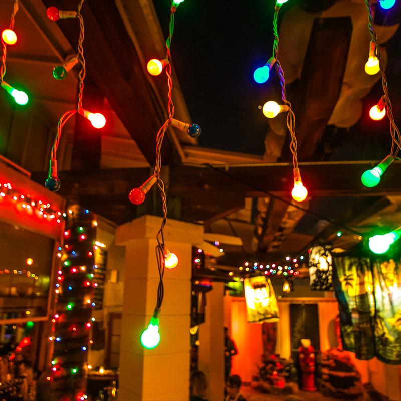 A scene of the patio with holiday lights every where