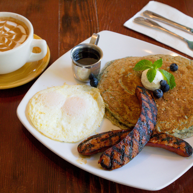 blue cornmral pancake combo with portuguese sausage and eggs