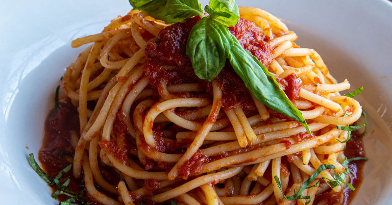Spaghetti with tomato sauce and meat closeup