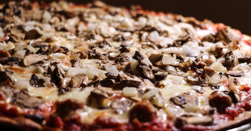 Pizza with spices and mushrooms