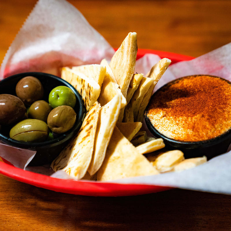 Olives, triangle bread and dip