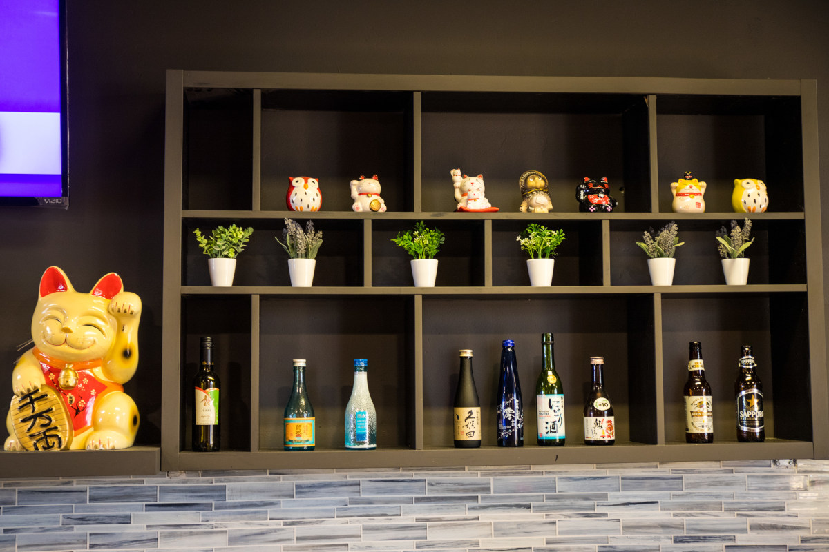 Shelves with wine, flowers and decorations