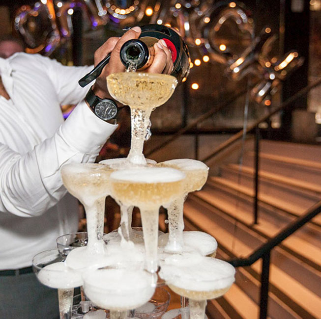 Employee pouring champagne