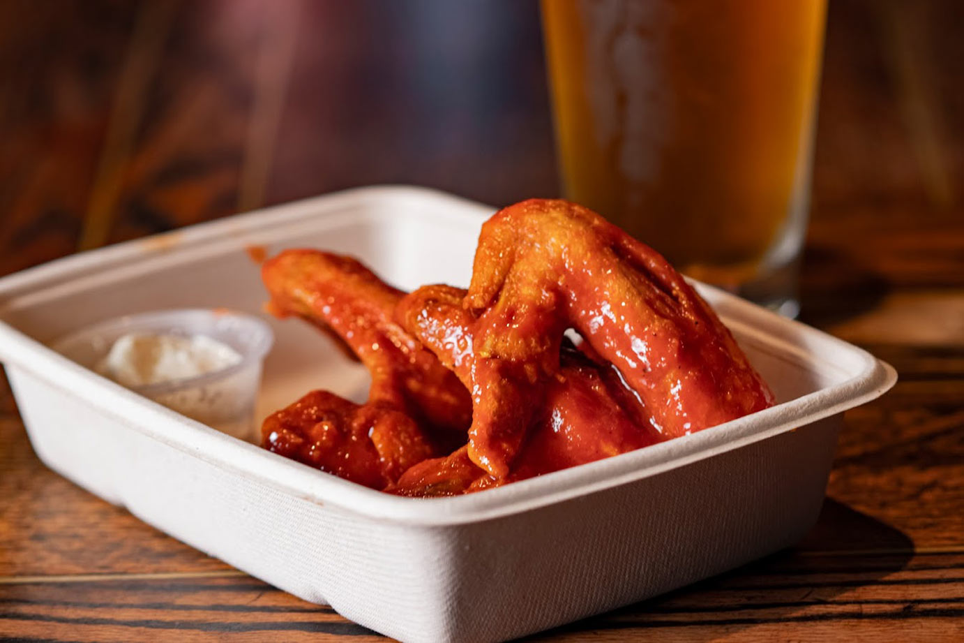 Fried chicken wings with beer