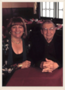 An older photo of a smiling couple