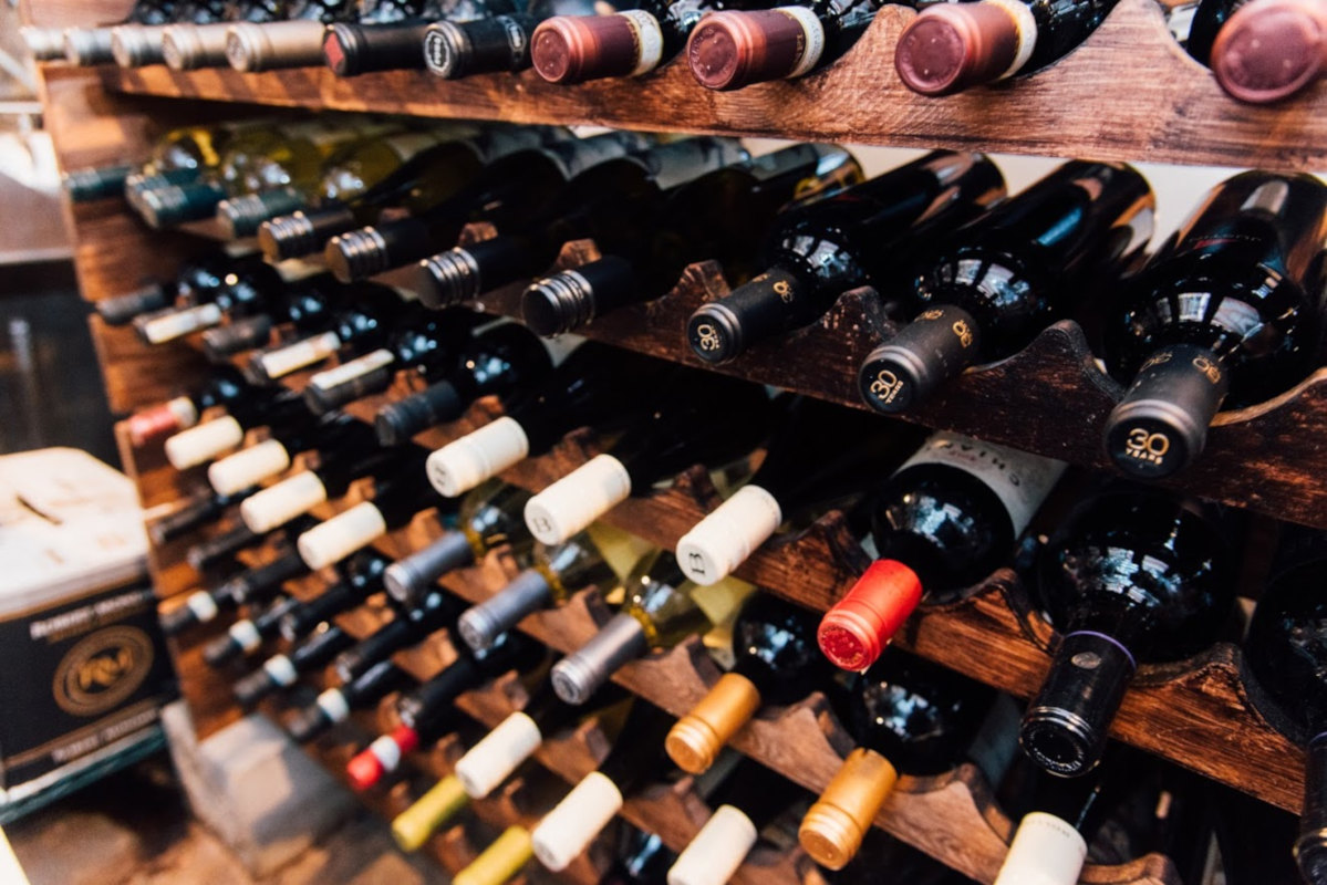Rack with bottles of wine