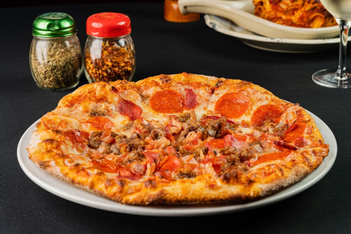 Pizza and spices on the side