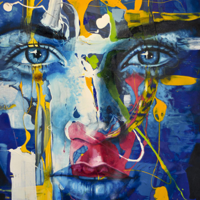 Painting of a face, blue with yellow hints