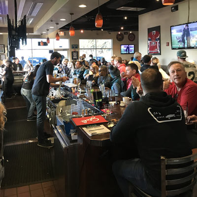 Crowded bar area during the game