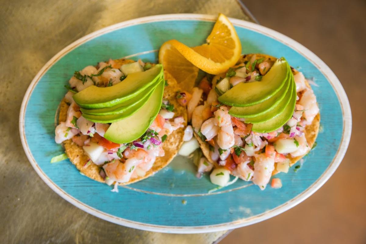 shrimp tacos with avocado on top