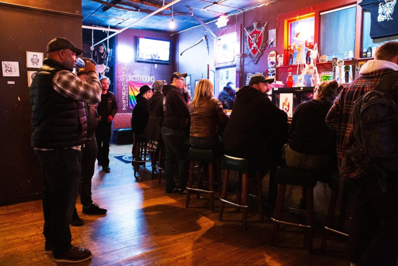 Restaurant interior, guests sitting at the bar, having fun