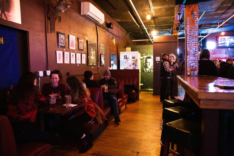 Restaurant interior, guests sitting, bar area