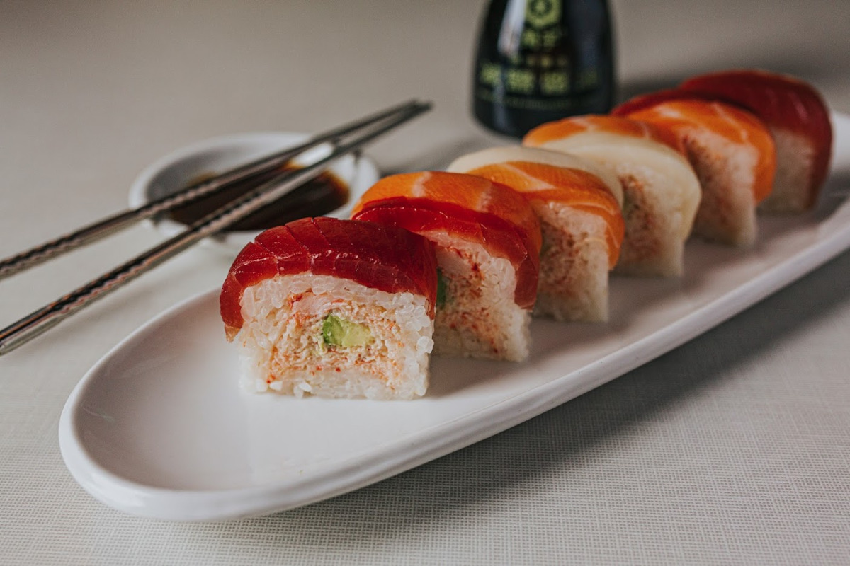 Snow crab, avocado, and rice served box style with the nigiri topping of your choice