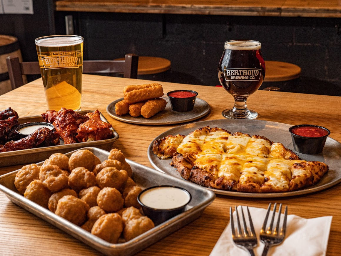 Different types of food and beer on the table