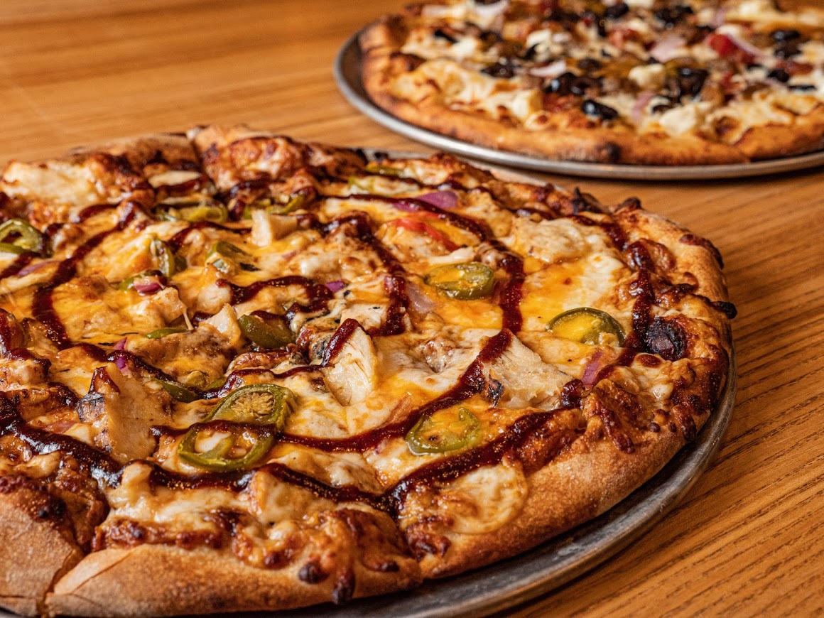 Pizza with extra cheese and vegetables
