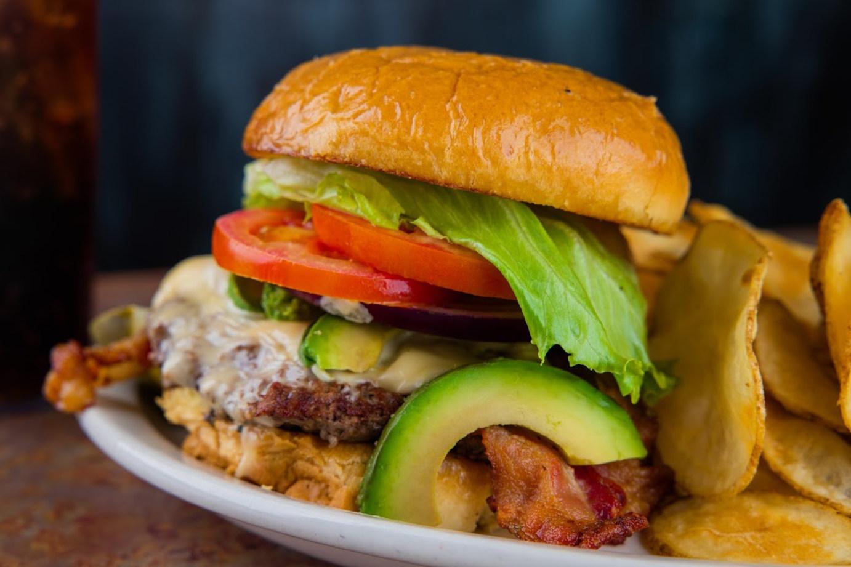 Burger, snacks on the side, closeup