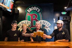 Staff members enjoying beer