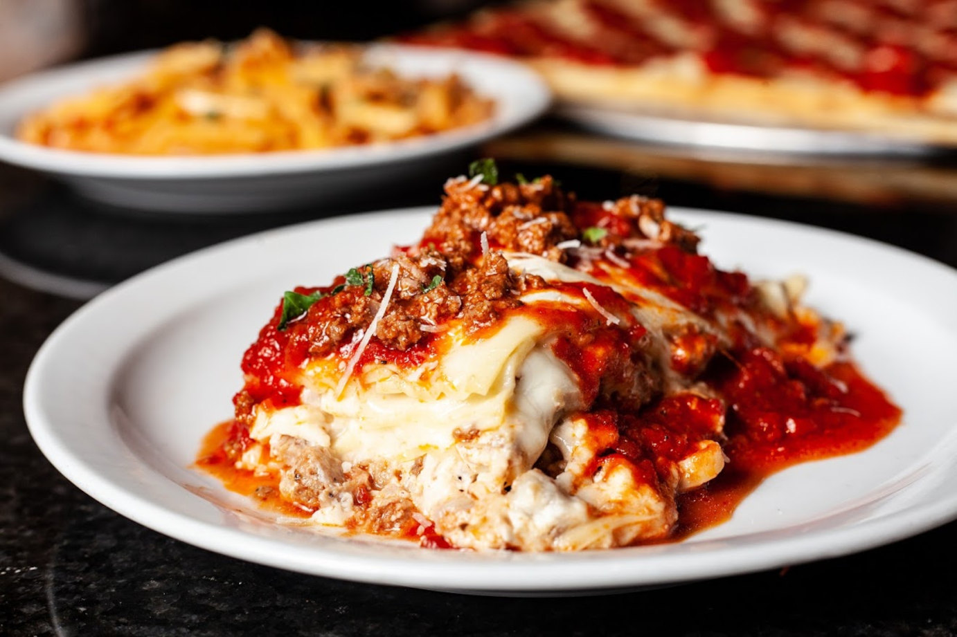 Pasta with melted cheese and tomato sauce