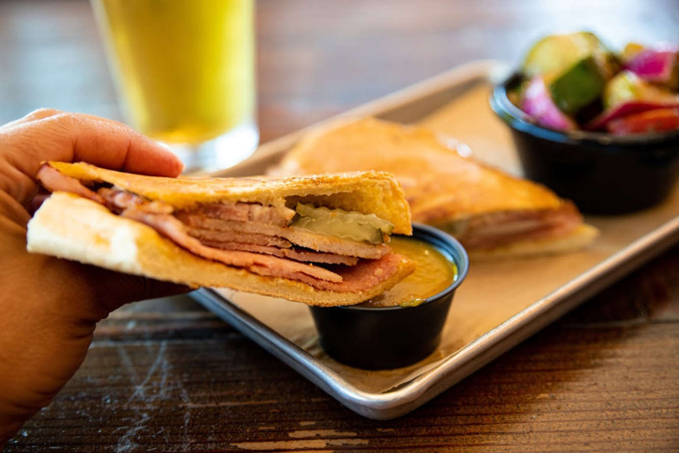 Sandwich, dip, salad glass of beer on the side