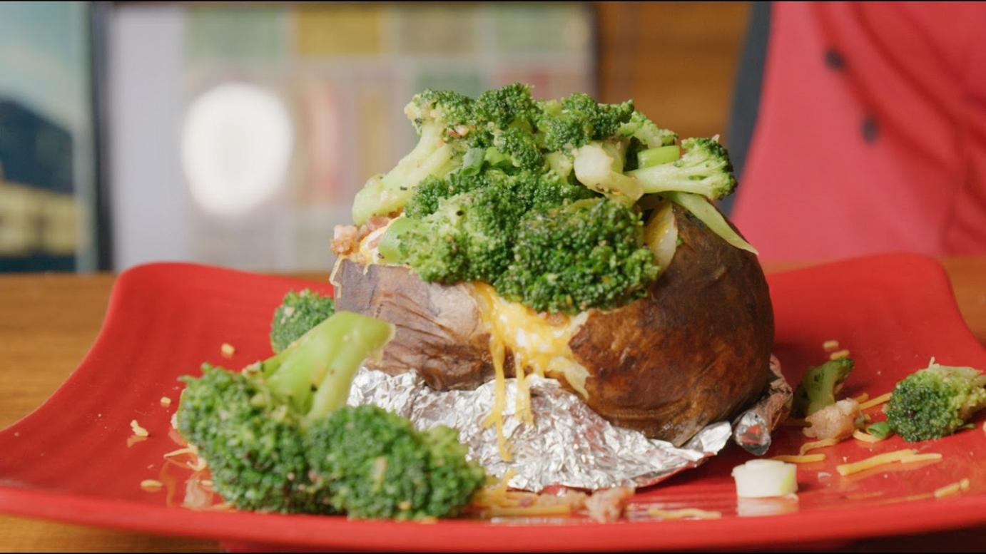 Baked potato with cheese and vegetables