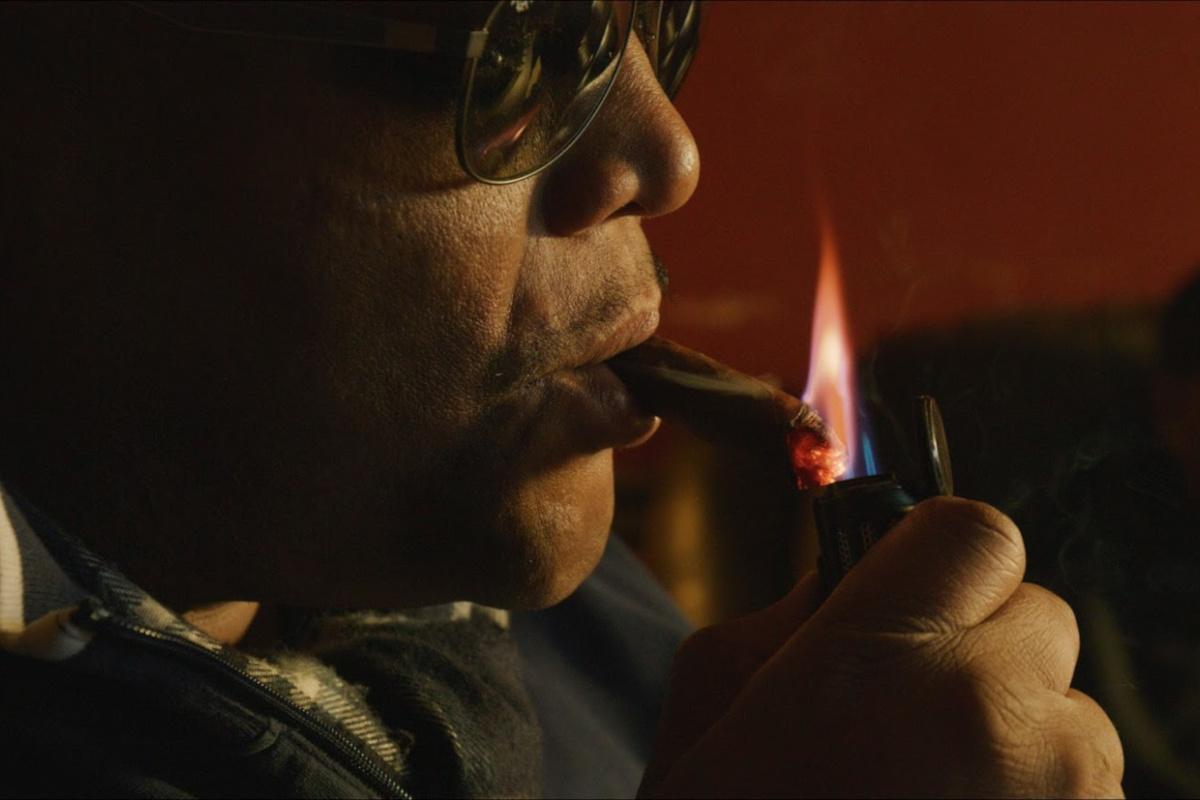 a man enjoying a cigar