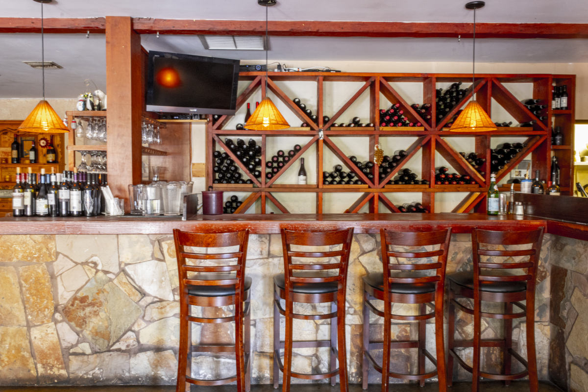 Caffe Pinguini bar with wine rack, wine bottles