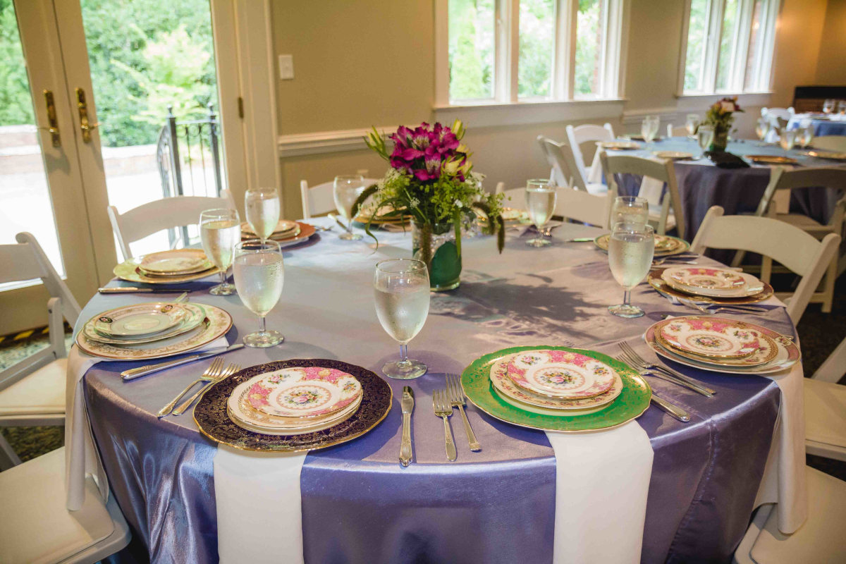 colorful plates on purple tablecloth