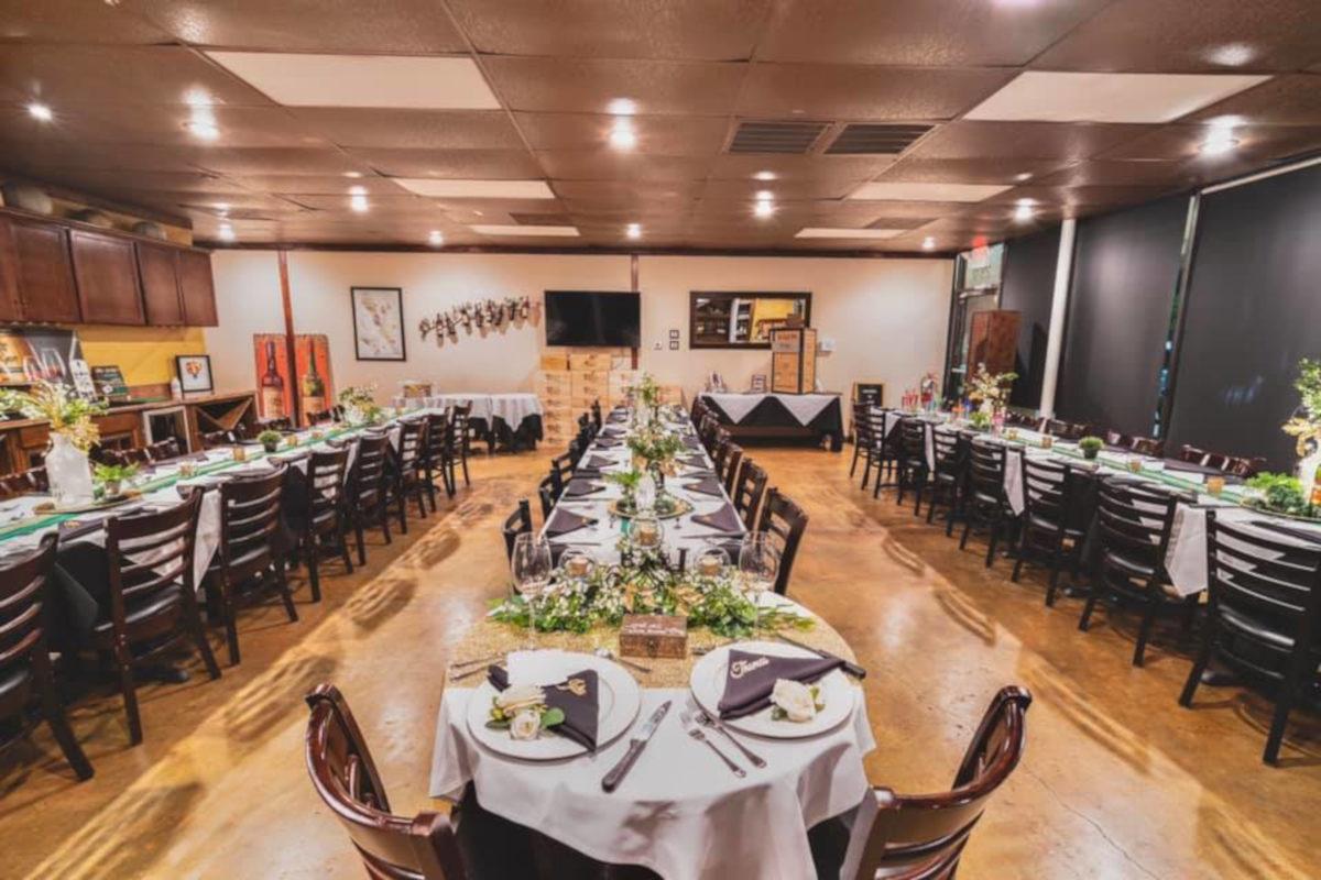private party area, purple napkins, white plates, wine glasses