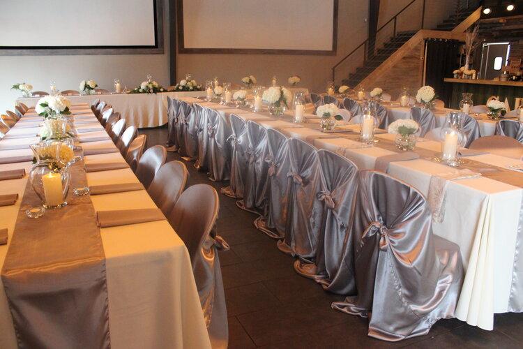 Set tables for wedding reception, elegant silver decorations