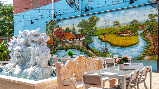 Outdoor, fountain, tables and mural