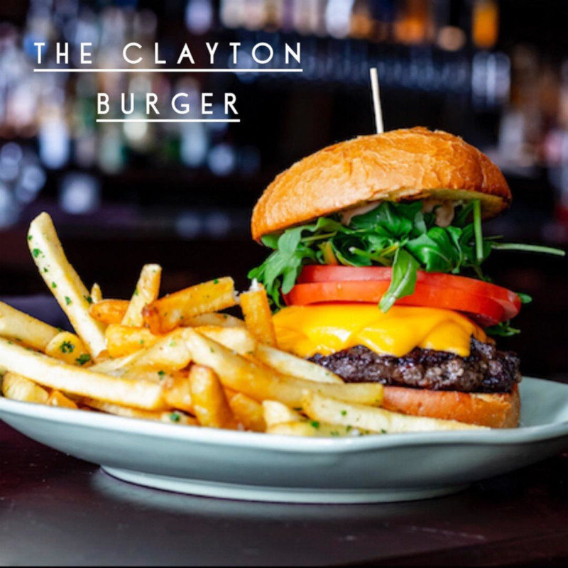 The Clayton Burger with french fries on the side