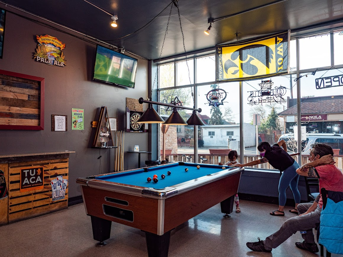 Interior, guests playing a pool game