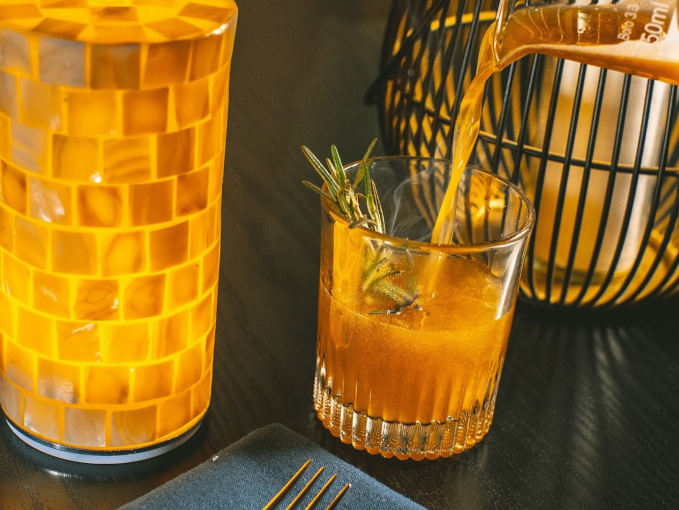 Orange cocktail, decorations on the side
