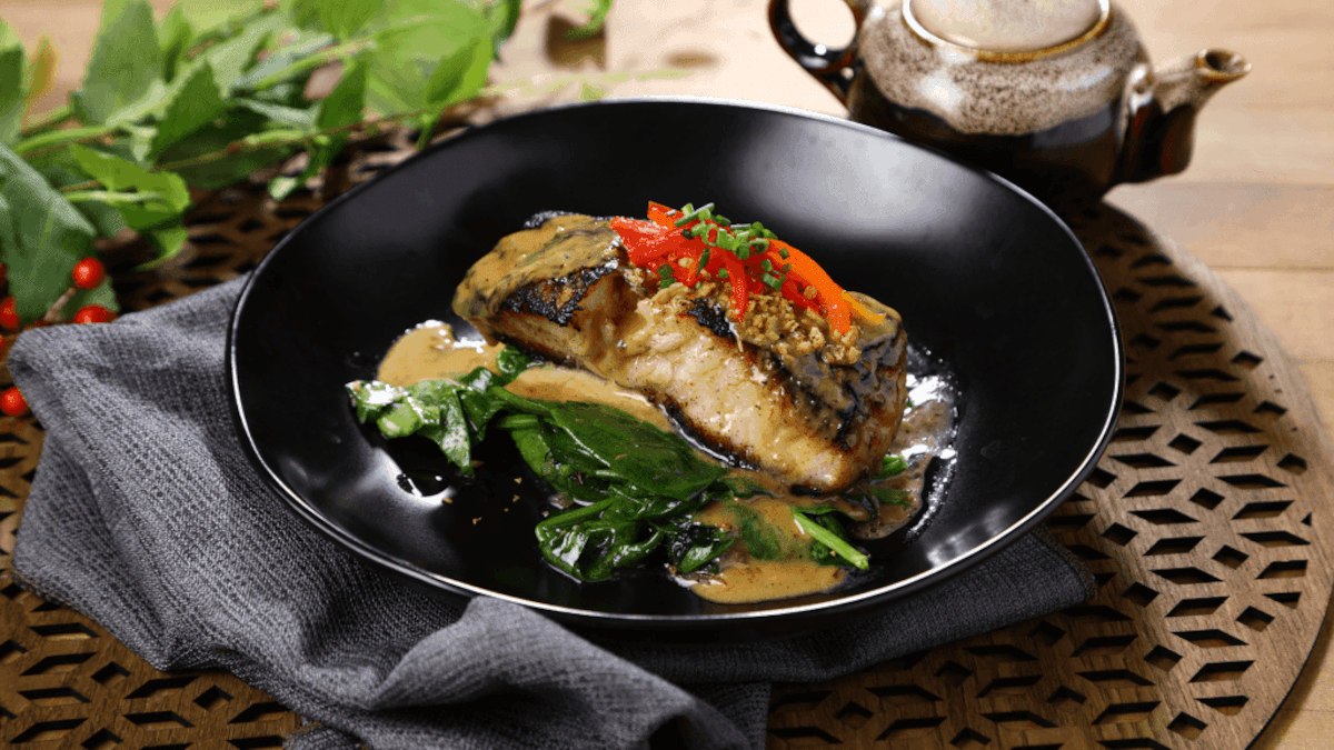 Grilled marinated seabass served with sautéed spinach