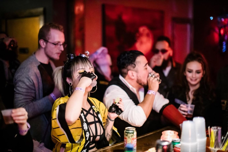 Interior, guests drinking at the bar
