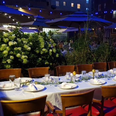 Exterior at night, table ready for guests