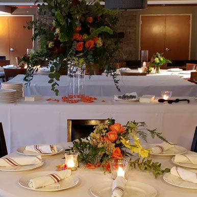 Interior, tables lined up, ready for guests