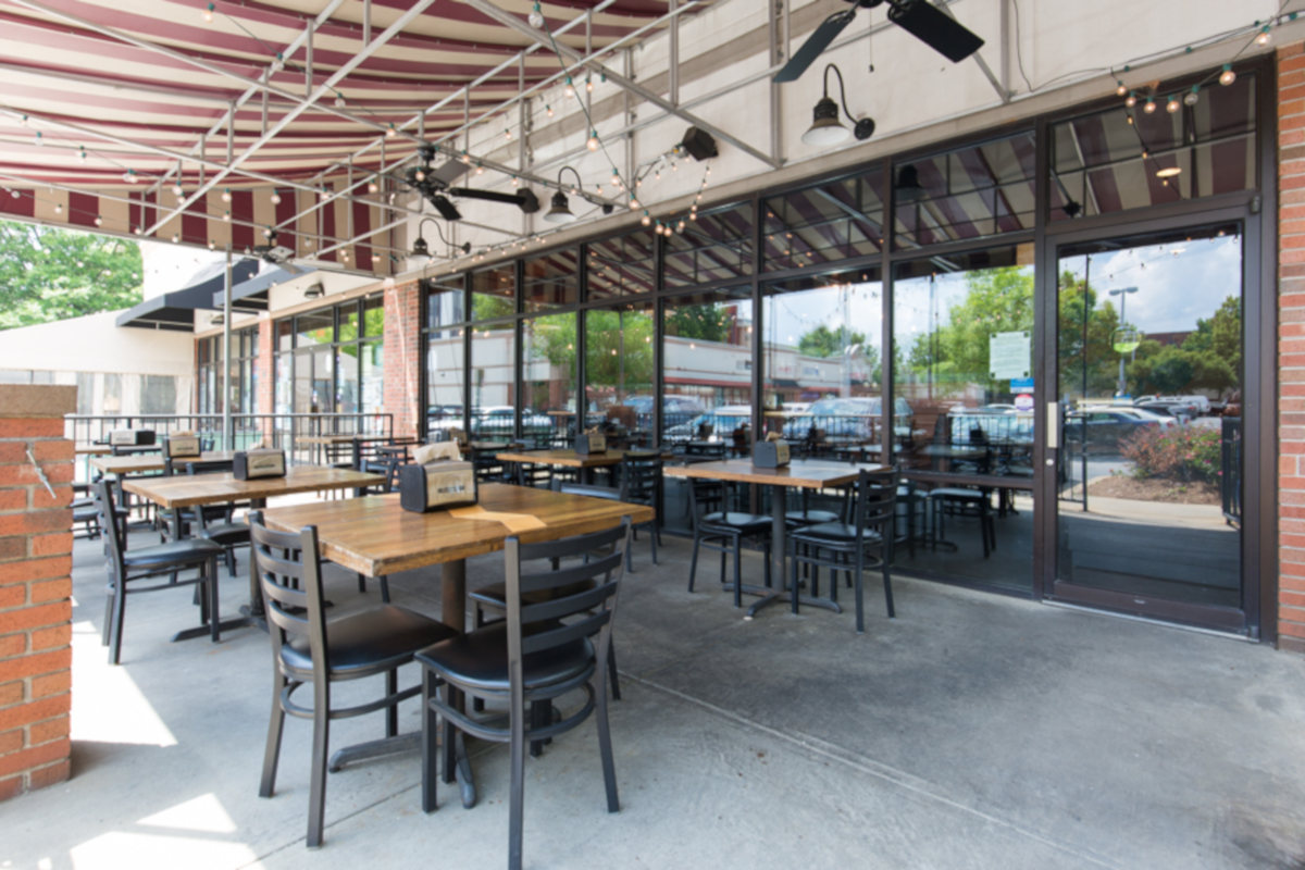 Restaurant exterior, tables lined up
