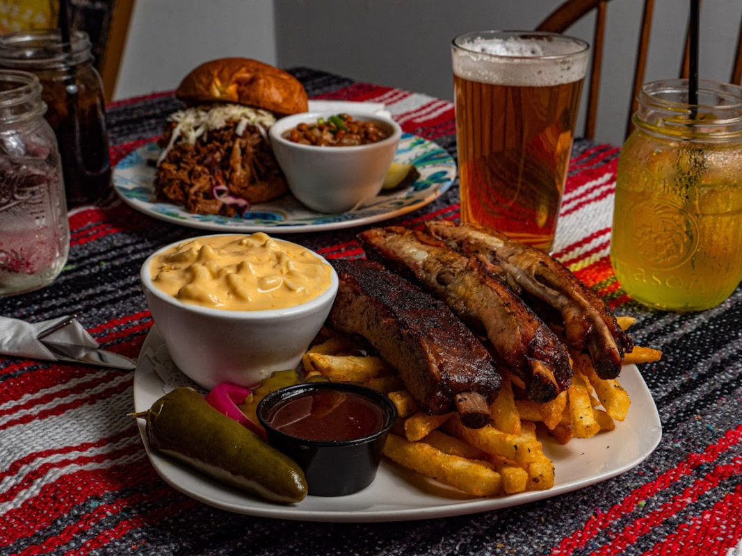 Grilled meat, fries and dips on the side