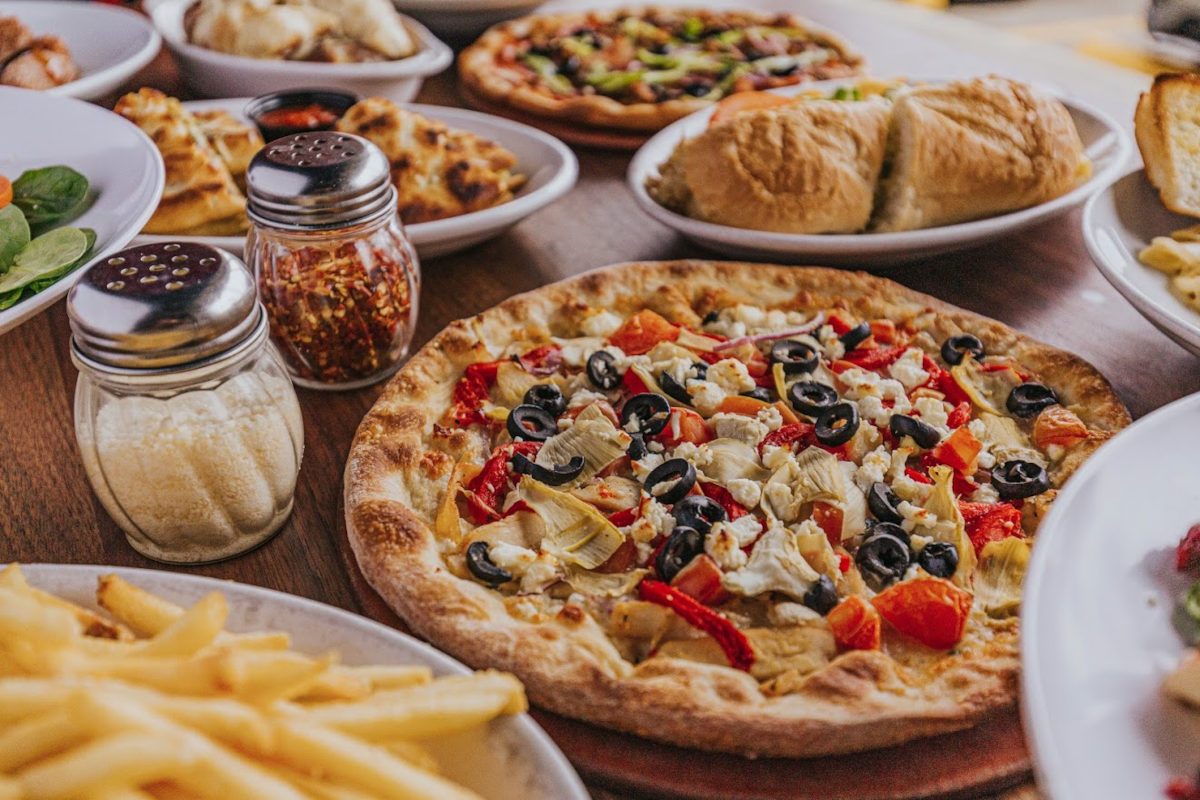 Pizza and different types of food on the table