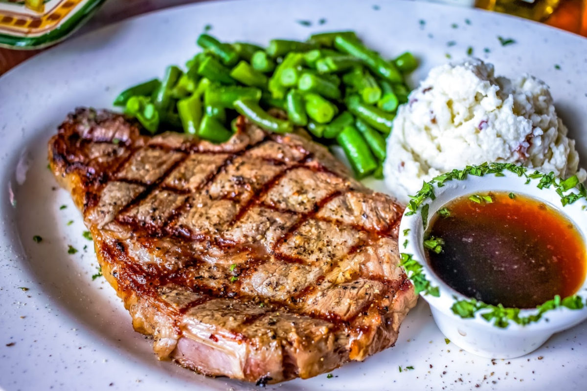 Steak dish with sides and sauce