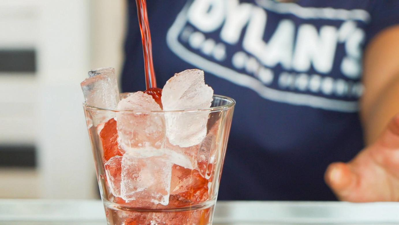 Red cocktail with ice closeup