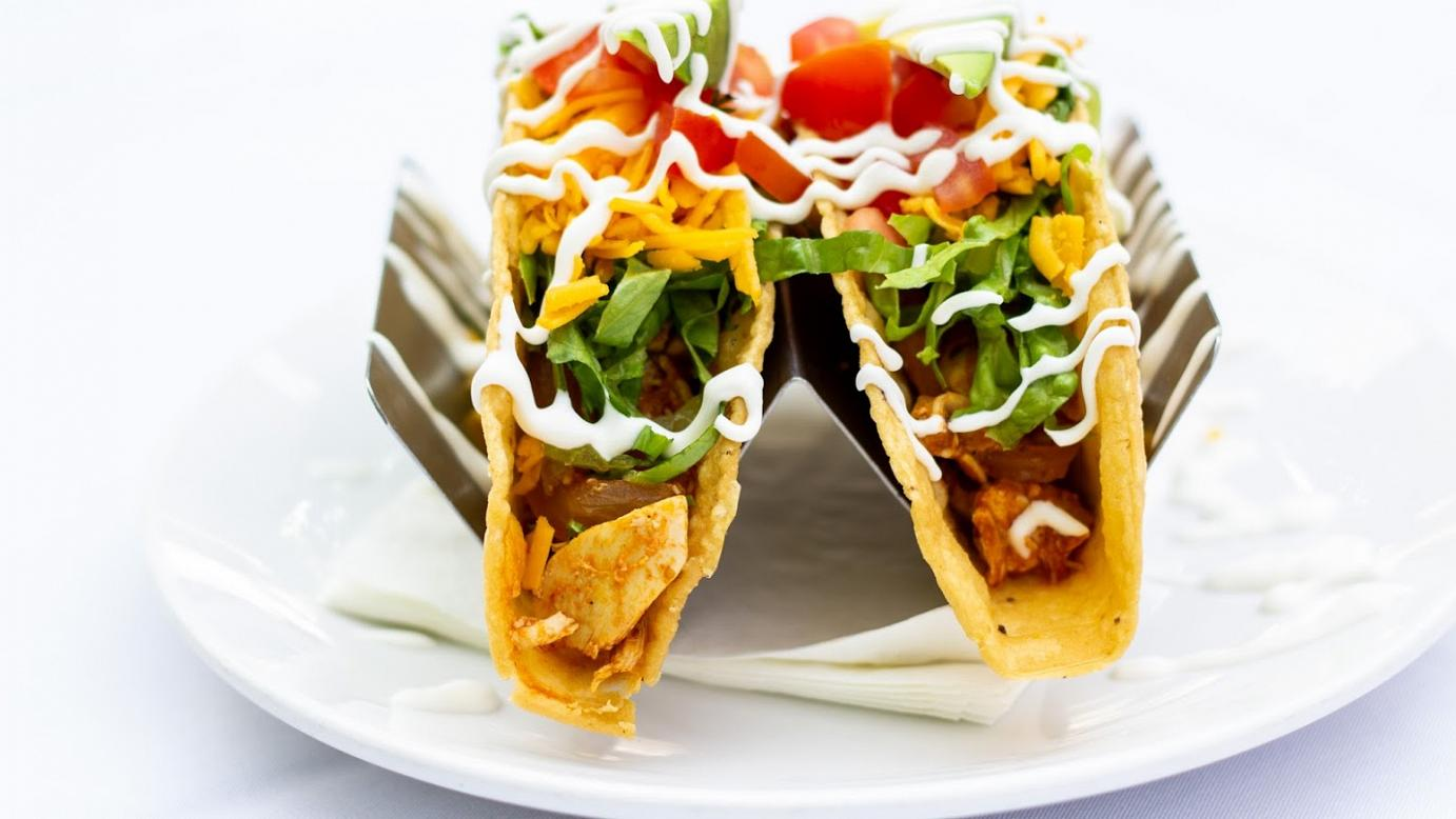 Two tacos with meat and vegetables