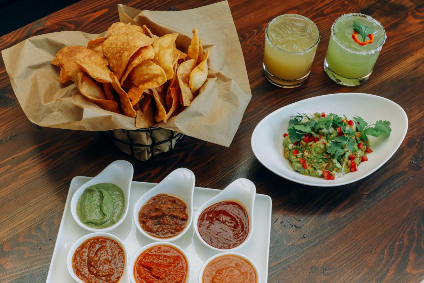 Nachos with dips and guac sauce