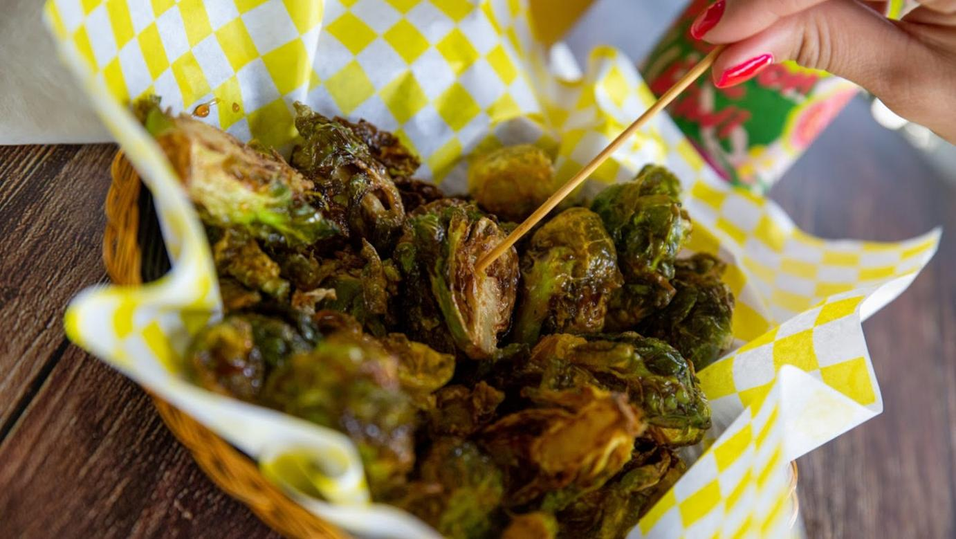 Fried Brussel Sprouts tossed in a syrup and sprinkled with salt
