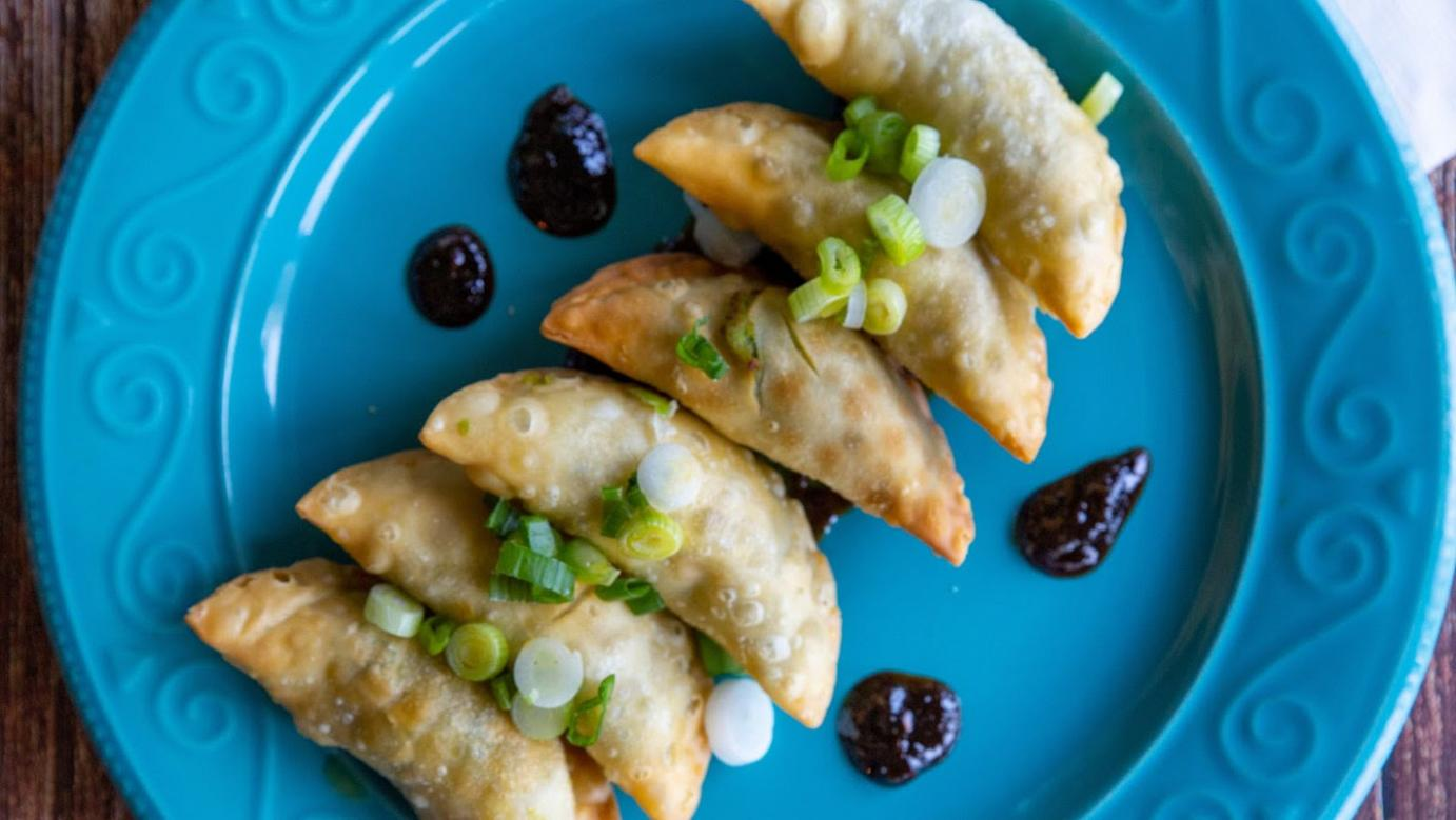 fried dumplings filled with avocado, red pepper, and green onion