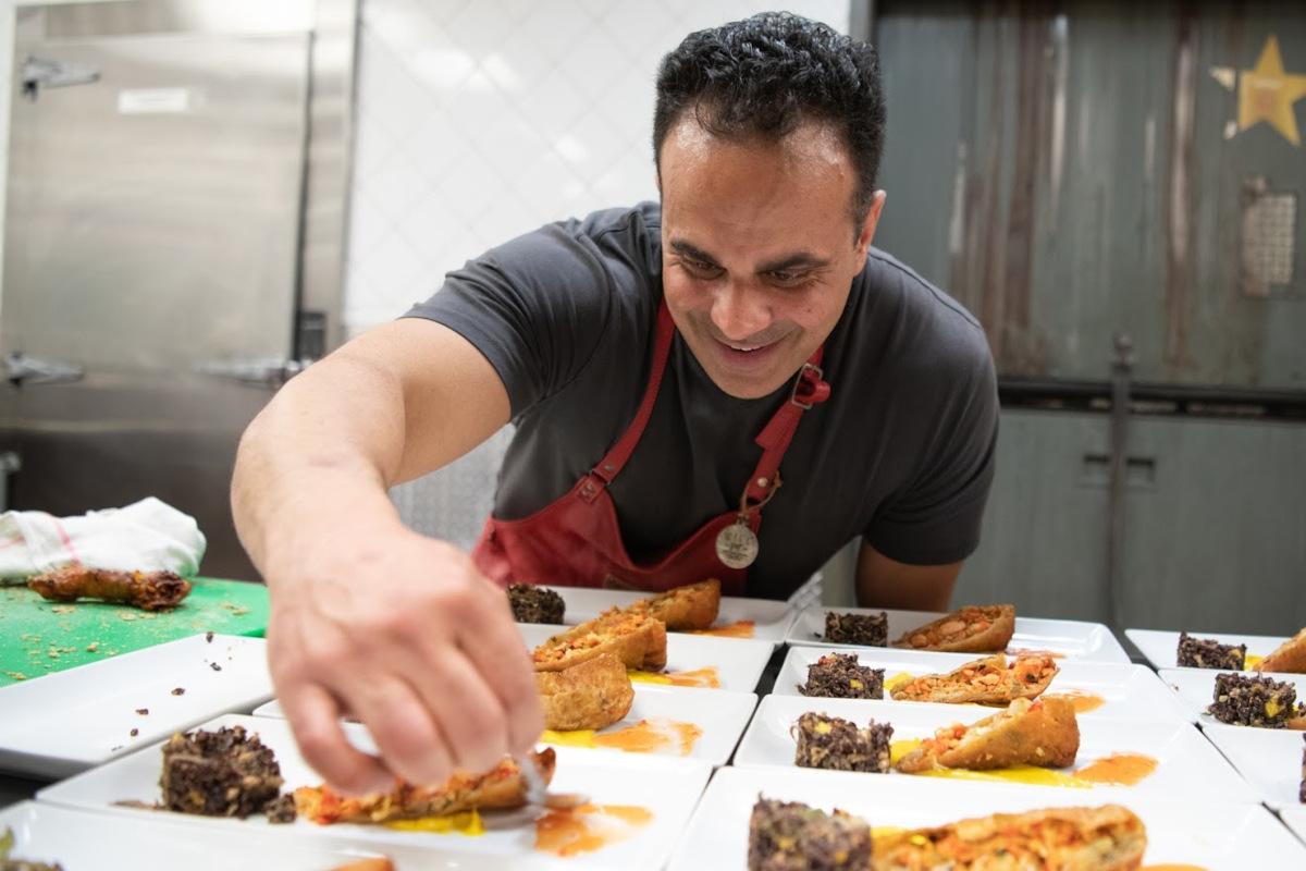 Staff member preparing food