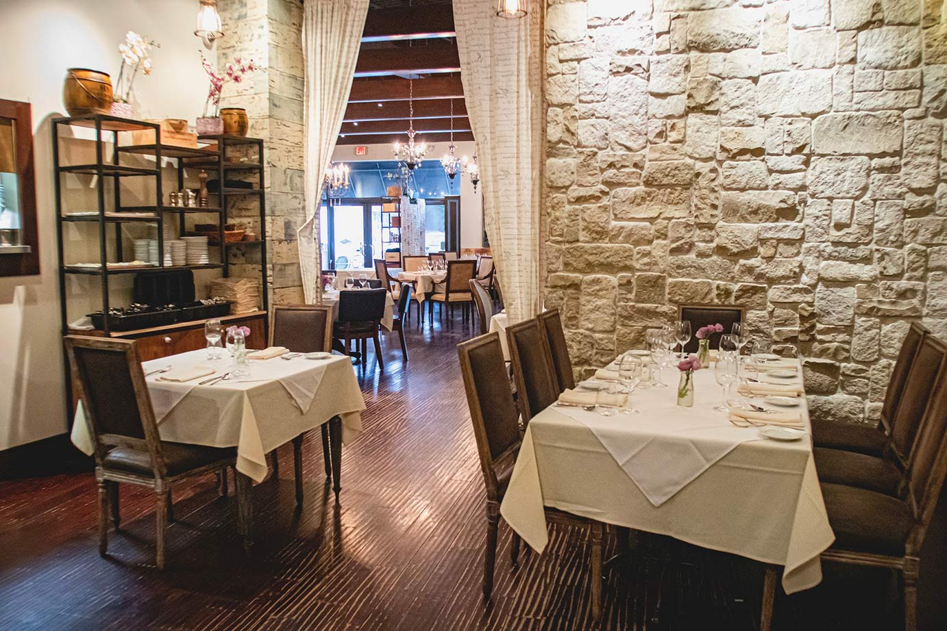 Two tables and a stone brick wall