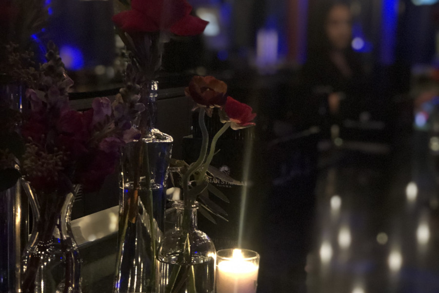 red roses and a candle depicting a romantic atmosphere